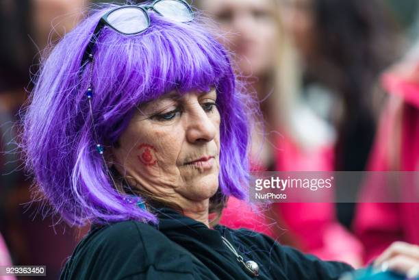 A woman participates in a march organized by Non una di meno movement during a one day strike to defend womens right on International Womens day in...