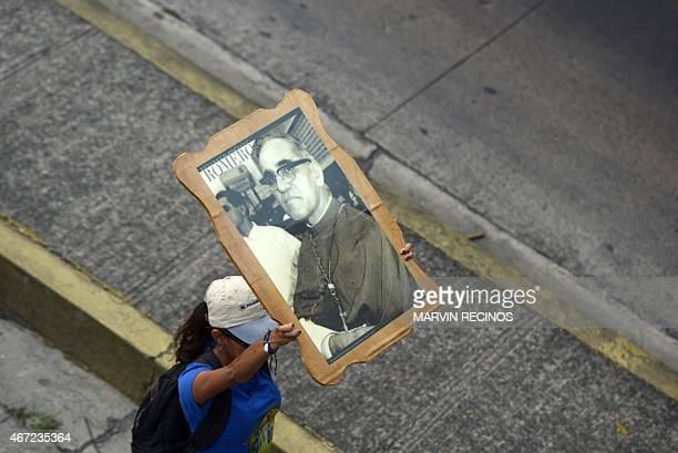 A woman participates in a pilgrimage in San Salvador on March 21 2015 as part of the events to commemorate the 35th anniversary of the assassination...