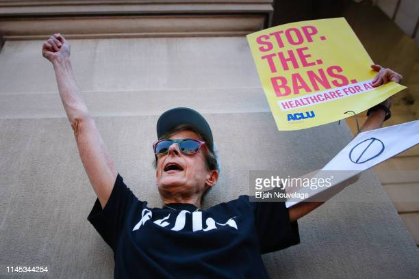A woman participates in a protest against recently passed abortion ban bills at the Georgia State Capitol building on May 21 2019 in Atlanta Georgia...