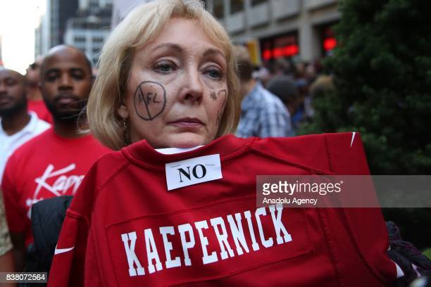A woman participates in a rally against the National Football League supporting Colin Kaepernick in Manhattan borough of New York United States on...