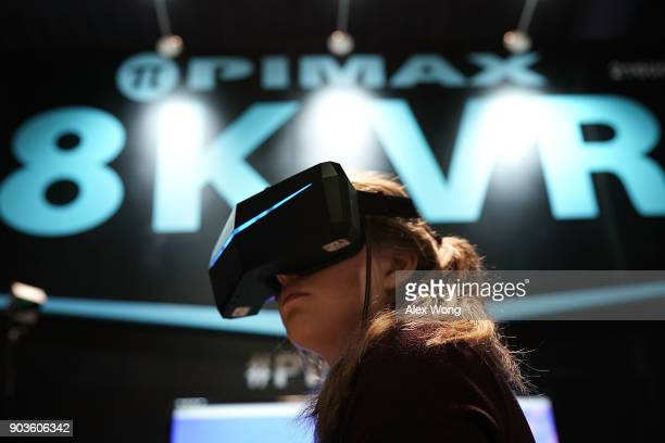 A woman participates in an 8K VR experience during CES 2018 at the Las Vegas Convention Center on January 10 2018 in Las Vegas Nevada CES the world's...