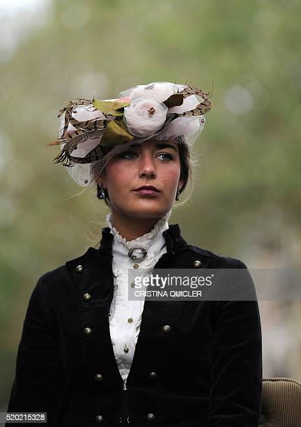 A woman participates in the XXXI 'Enganches' exhibitiont at the Real Maestranza bullring in Sevilla on April 10 2016 / AFP / CRISTINA QUICLER