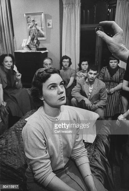 A woman participating in a hypnotism session