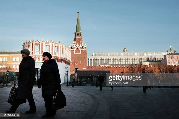 Woman pass by the entrance to the Kremlin on March 10 2017 in Moscow Russia Relations between the United States and Russia are at their lowest point...