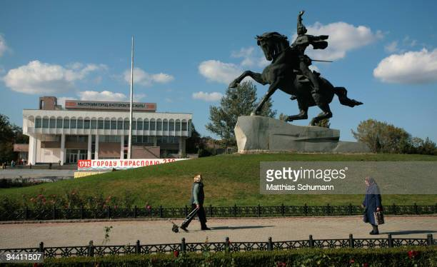 Woman pass October 19, 2008 the statue of Alexander Suvorov the founder of Tiraspol in the Transnistria region in Moldova. Tiraspol is the second...