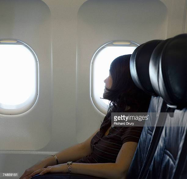 woman passenger sleeping on airplane - richard drury stock pictures, royalty-free photos & images