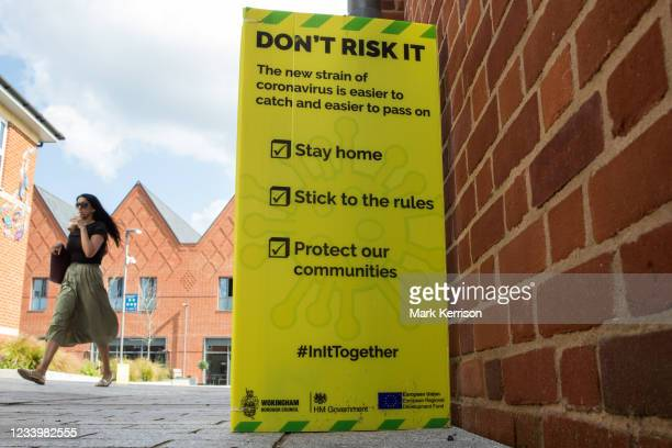 Woman passes a Covid-19 public information notice regarding the Delta variant on 14th July 2021 in Wokingham, United Kingdom. The leader of Wokingham...