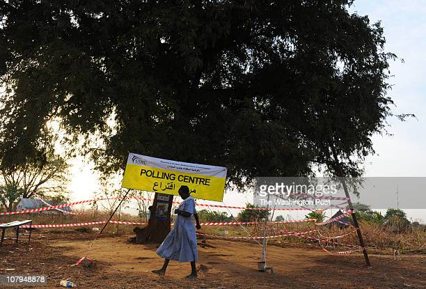 A woman passes a remote polling station after the closing of the first day of the historic independence referendum on January 9 2011 in Bungu Sudan A...