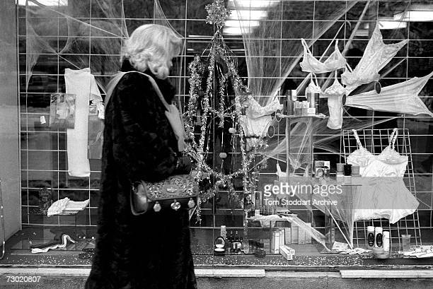 A woman passes a shop window filled with lingerie and christmas decorations after the ceasefire ended hostilities During the 47 months between the...