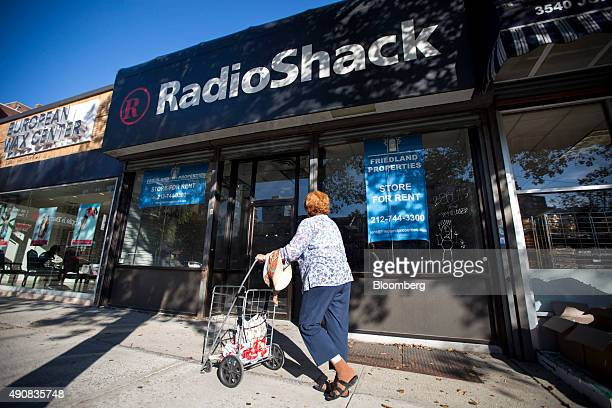 A woman passes by a former Radio Shack store at a vacant commercial space owned by Friedland Propertis on Johnson Avenue in the Bronx borough of New...