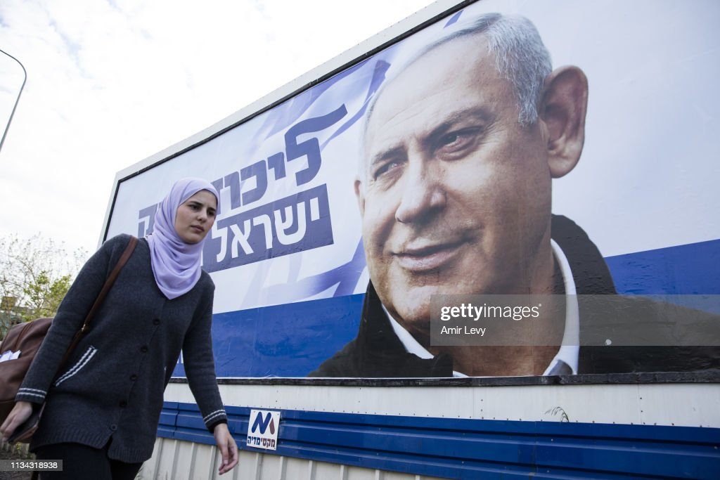 Israelis Look At Election Campaign Posters : News Photo