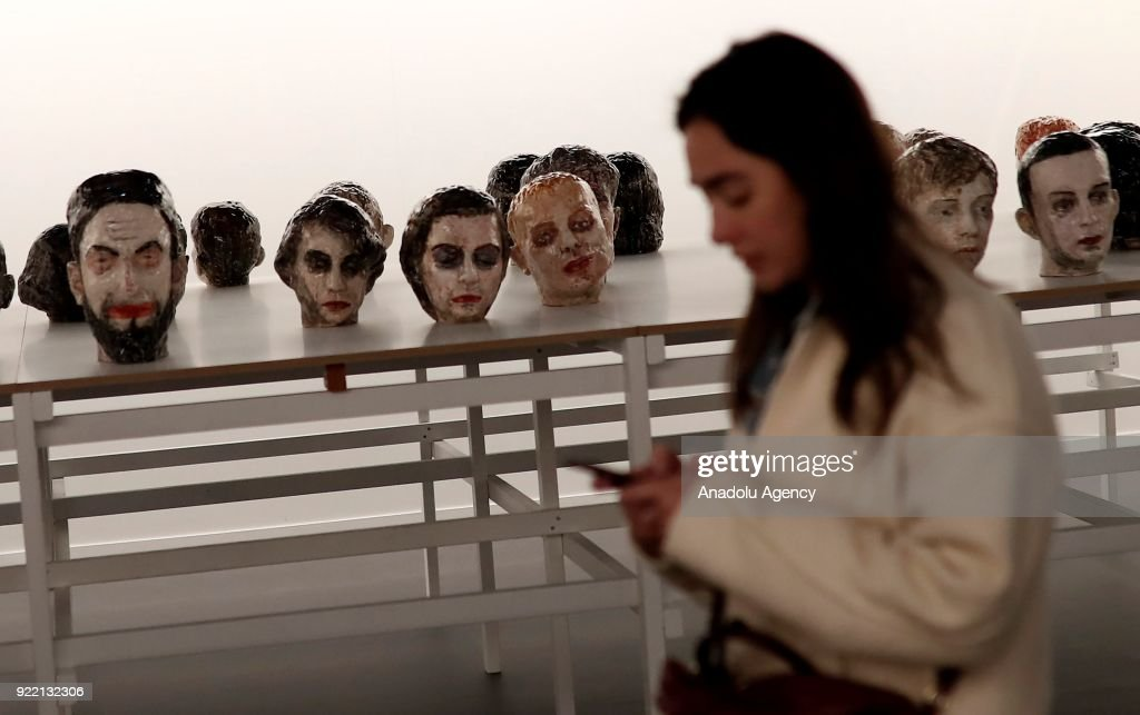 A woman passes by an artwork during ARCOmadrid 2018 in Madrid, Spain on February 21, 2018.