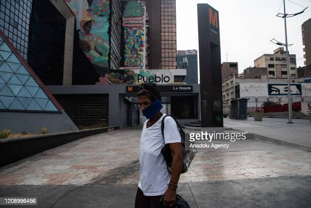 A woman passes by empty La Hoyada Subway station as a preventive measure against the new type of coronavirus pandemic in Caracas Venezuela on April...