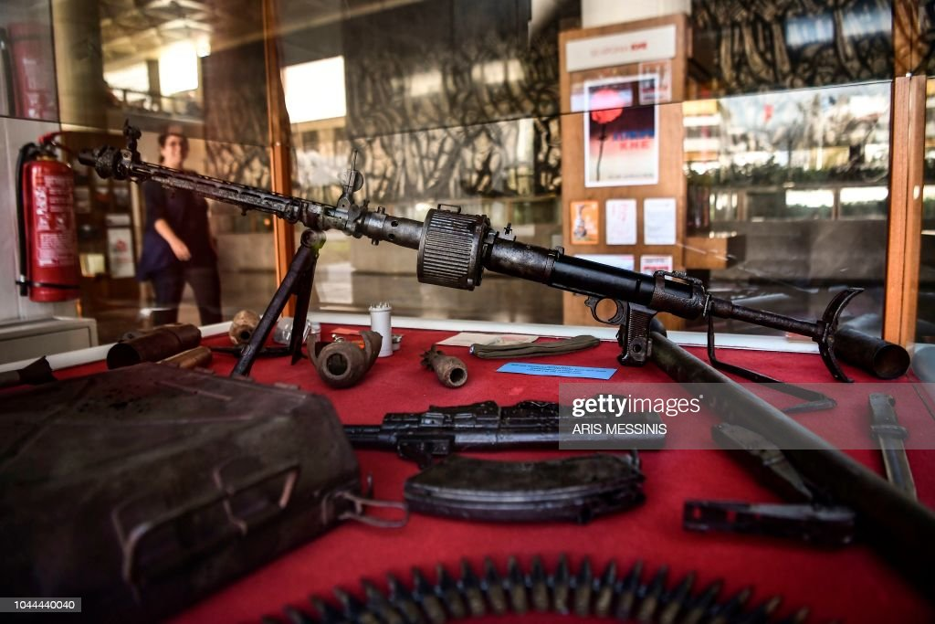 A woman passes by relics of Civil War weaponry in the hall