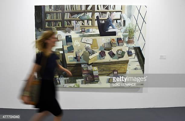 A woman passes by 'Retrato del artista como un joven escritor' an artwork by Carlos Huffmann during a press presentation of 'My Buenos Aires' an...