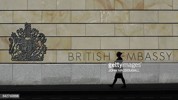 Woman passes by the British Embassy on June 24, 2016 in Berlin. Britain voted to leave the European Union in a so-called Brexit referendum on June...
