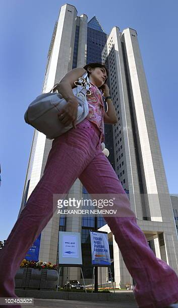 A woman passes by the headquarters of Russian gas giant Gazprom during the annual meeting in Moscow on June 25 2010 A fourday energy spat between...