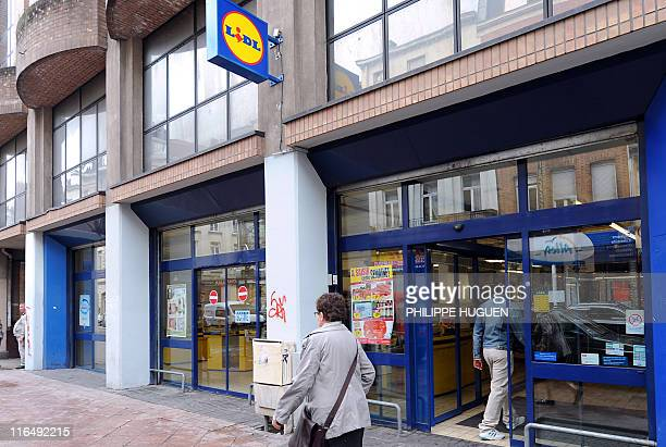 A woman passes in front of a discount supermarket LIDL on June 16 2011 in the northern French town of Lille Six children were being treated in...
