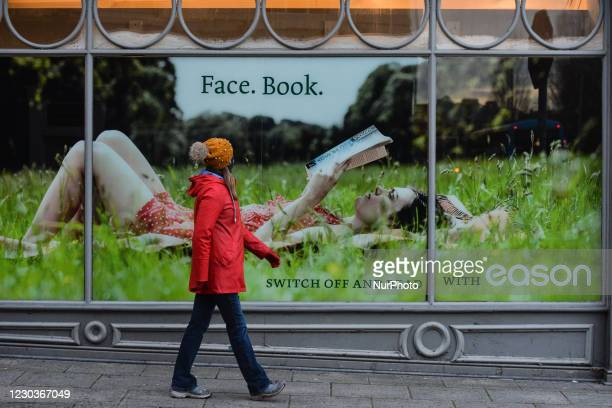 Woman passes in front of Eason shop in Dublin city center. This evening, Taoiseach Micheal Martin announced a return to full Level 5 restrictions...