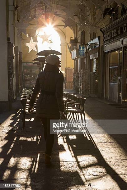 Woman passes outdoor cafe