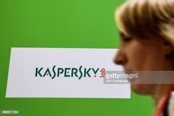 A woman passes the logo of Kaspersky Lab Russia's leading antivirus software development company during the 10th Russian Internet Week in Moscow on...