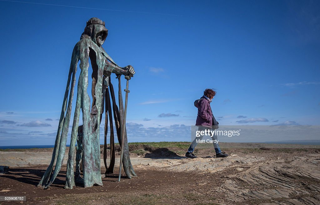 A woman passes the new 'Gallos' sculpture that has been erected at Tintagel Castle in Tintagel on April 28, 2016 in Cornwall, England. The English Heritage managed site and the nearby town have long been associated with the legend of King Arthur and continue to attract large visitor numbers. However, efforts by English Heritage to update the visitor experience with the Gallos sculpture, along with a rock carving of Merlin's face, which English Heritage say are inspired by the legend of King Arthur and Tintagel Castles royal past, have met with criticism from some Cornish nationalists and historians.