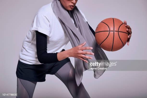Woman passing basket ball