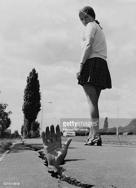Woman Passing By A Plastic Hand At Essex In Basildon On August 1970