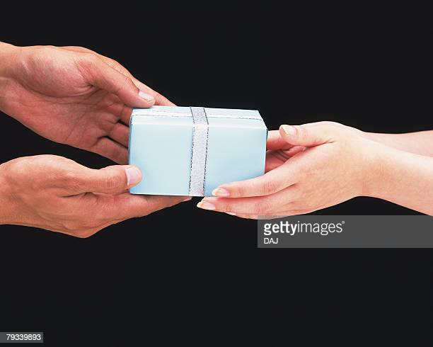 Woman passing present to man
