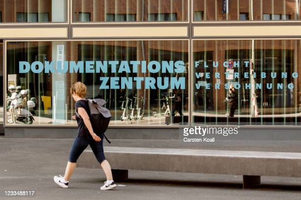 Woman passing the new Documentation Center for Displacement, Expulsion and Reconciliation on June 16, 2021 in Berlin, Germany. The center, documents...