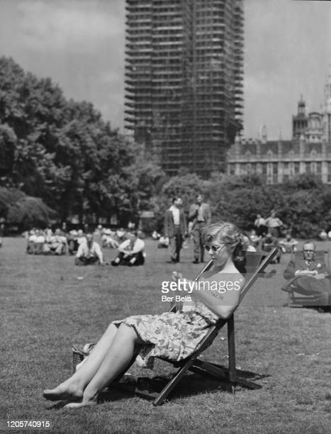 A woman Patricia Philpot relaxing and knitting at lunch time in Victoria Gardens during a heat wave London UK 30th June 1952