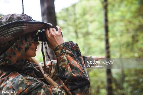 Woman patrol with binocular