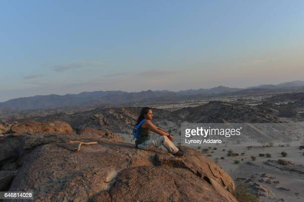 A woman pauses as a group of Saudis and a few foreigners hike through the desert/ mountains about 50 miles North east of Jeddah in Al Kamel