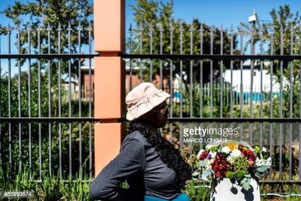 A woman pauses at the monument commemorating the victims of the 1960 Sharpeville massacre in Sharpville on March 21 2017 On March 21 1960 after a day...