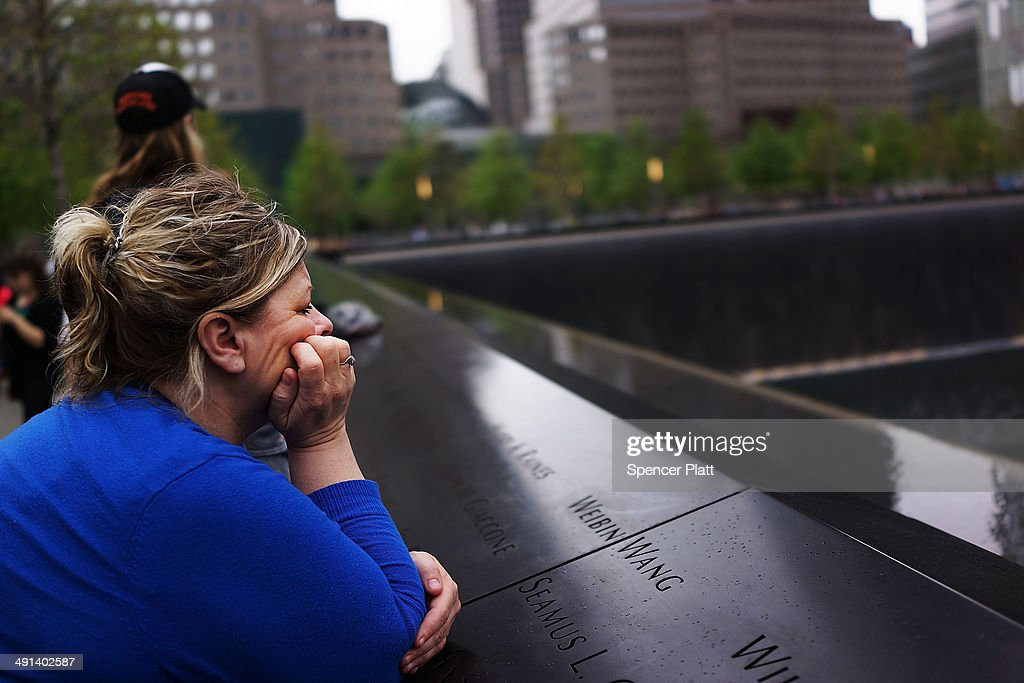 A woman pauses at the names engraved along the North reflecting pool at the ground zero memorial site after authorities opened the plaza to the public free of charge on May 16, 2014 in New York City. Prior to today, visitors had to wait in line to enter a barricaded area which includes the newly dedicated National September 11 Memorial Museum. Together with the museum, Ground Zero has become one of the top tourist attractions in the nation with tens of thousands of visitors expected yearly.