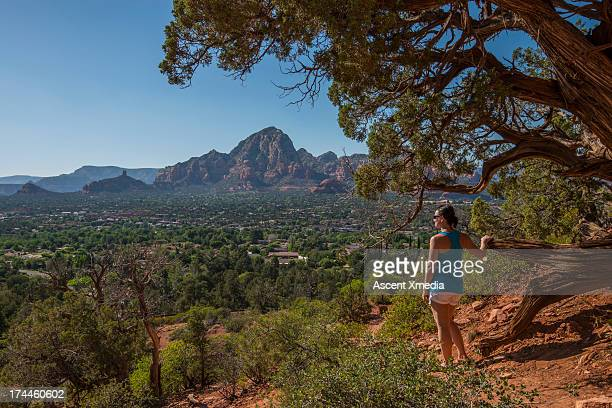 Woman pauses at trailside, looks out to view