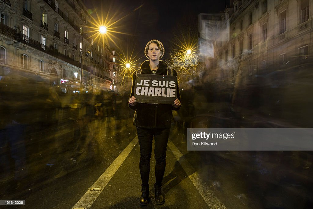 A woman pauses for a picture during a mass unity rally following the recent Paris terrorist attacks on January 11, 2015 in Paris, France. An estimated one million people have converged in central Paris for the Unity March joining in solidarity with the 17 victims of this week's terrorist attacks in the country. French President Francois Hollande led the march and was joined by world leaders in a sign of unity. The terrorist atrocities started on Wednesday with the attack on the French satirical magazine Charlie Hebdo, killing 12, and ended on Friday with sieges at a printing company in Dammartin en Goele and a Kosher supermarket in Paris with four hostages and three suspects being killed. A fourth suspect, Hayat Boumeddiene, 26, escaped and is wanted in connection with the murder of a policewoman.