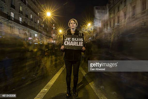 A woman pauses for a picture during a mass unity rally following the recent Paris terrorist attacks on January 11 2015 in Paris France An estimated...