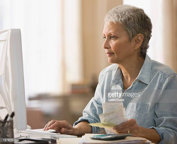 Woman paying bills on computer