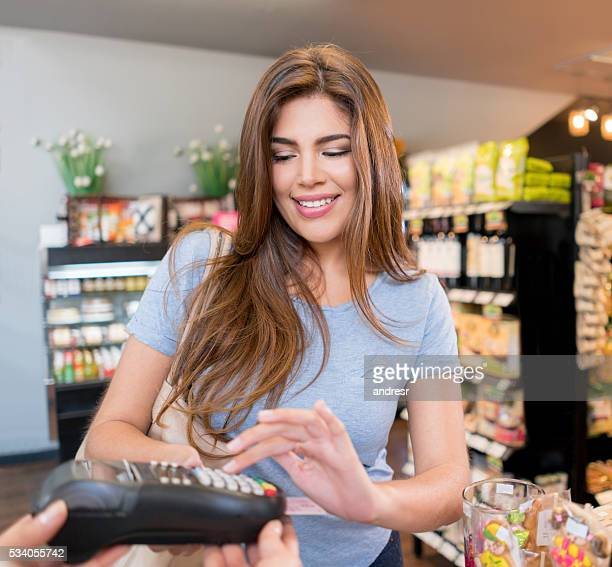 Woman paying by card at the supermarket