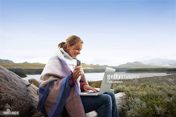 Woman paying for online purchases