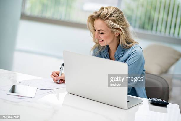 Woman paying her bills online on a laptop