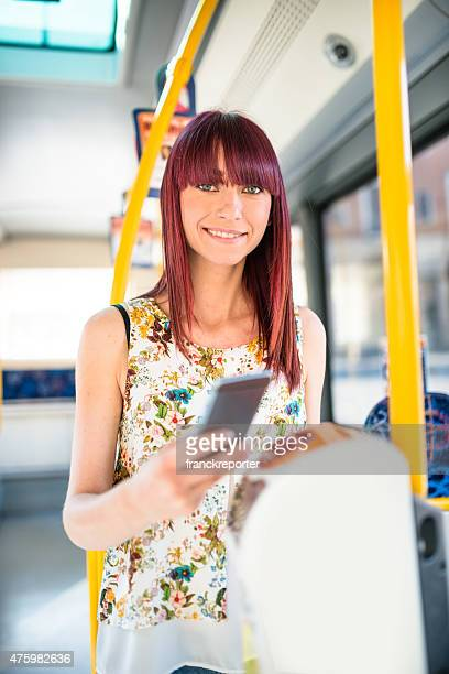 woman paying the bus ticket with the smartphone