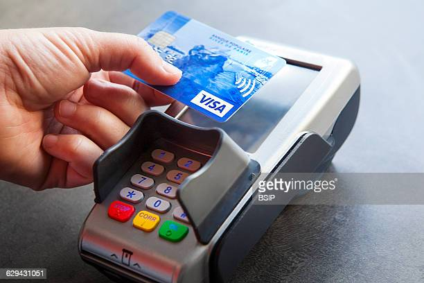 Woman paying with contactless credit card