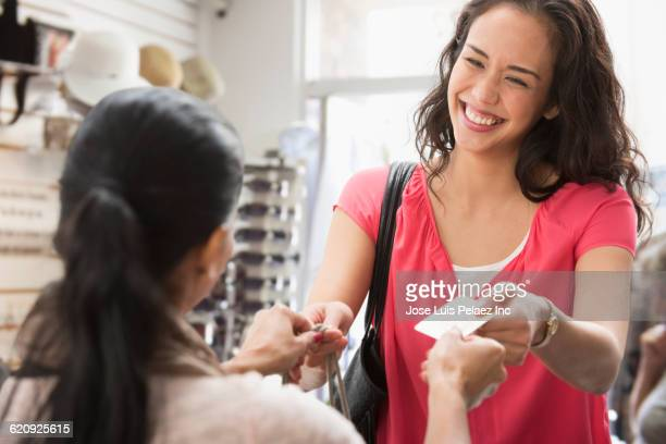 Woman paying with credit card in store