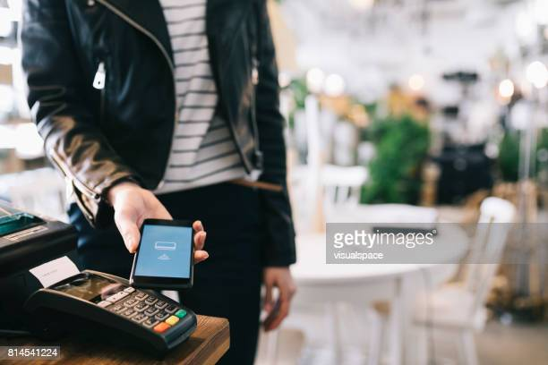 woman paying with smartphone. - credit card reader stock pictures, royalty-free photos & images