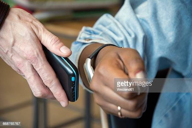 woman paying with smartwatch and nfc reader - nfc stock pictures, royalty-free photos & images