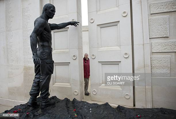 Woman pays her respects at the Armed Forces Memorial, which lists the names of British Armed Forces members who have died on duty since the Second...
