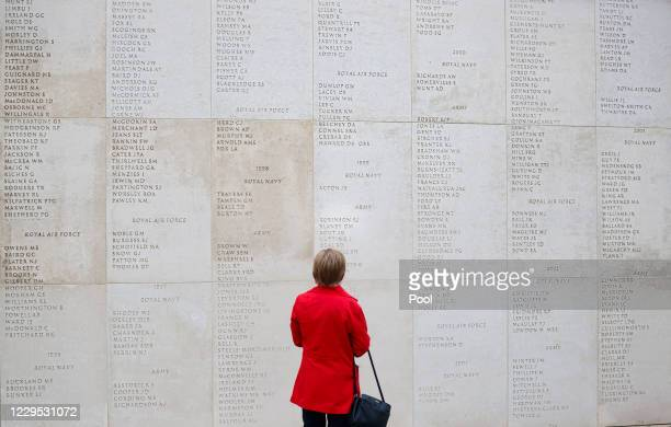 Woman pays her respects at the National Memorial Arboretum in Alrewas, following a 'virtual' Act of Remembrance from the Armed Forces Memorial which...