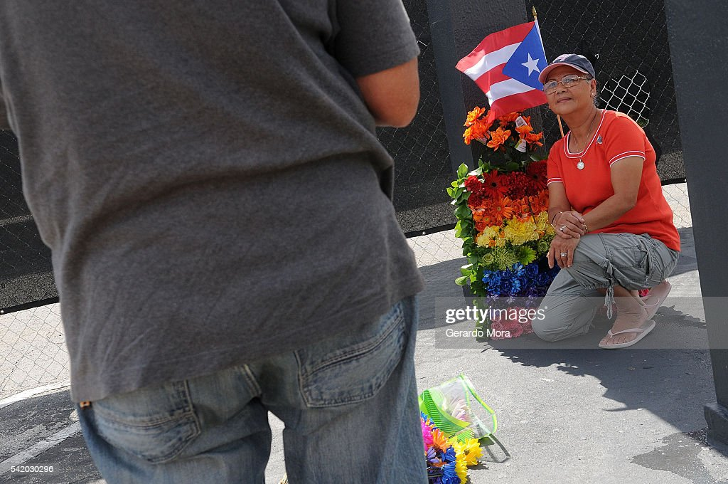 A woman pays her respects for the victims of the Pulse Nightclub shooting at the front of the nightclub building on June 21, 2016 in Orlando, Florida. The Orlando community continues to mourn the victims of the deadly mass shooting at a gay nightclub.